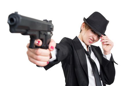 gangster background: beautiful girl gangster holding a gun. Classic suit and hat. isolated on white background.