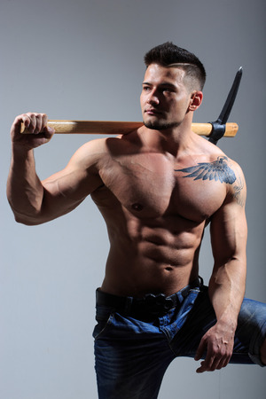 pickaxe: sexy Muscular man holding pickaxe. working stone mines.