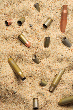 casings: cartridge cases on the sand. rifle and pistol cartridges