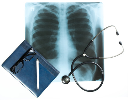 x rays negative: Doctors desk, medical concept. X-ray and stethoscope. Stock Photo