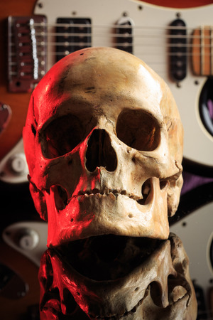melodist: Still life with skull and electric guitar. concept of heavy rock music Stock Photo