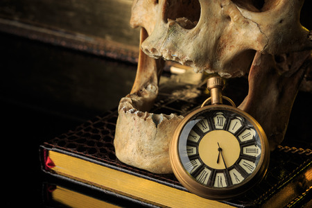 necromancer: human skull on a book next to the clock.