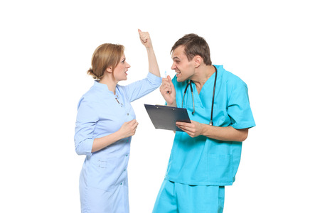 dissatisfaction: A medical team of doctors, man and woman, isolated on white background