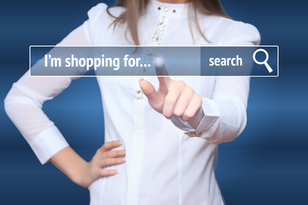 eshop: Woman click on virtual e-shop button with shopping cart. E-commerce and B2C concept. Stock Photo