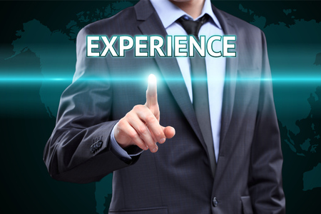 business, technology, internet and networking concept - businessman pressing experience button on virtual screens Banque d'images