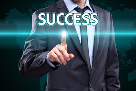 win win: businessman hand pushing success button on a touch screen interface