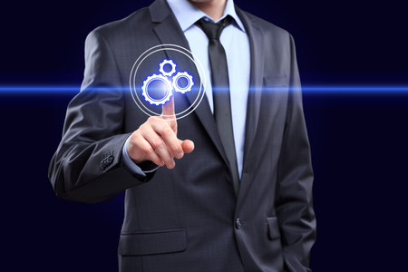 cogwheel: business, technology  concept - businessman pressing button with mechanism icon on virtual screens
