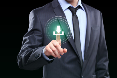 Man hand pushing download icon with virtual screen. Zdjęcie Seryjne