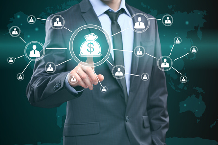 Businessman presses digital interface dollar sign on virtual screens.