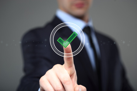 Close up of businessman touching making choice on media screen