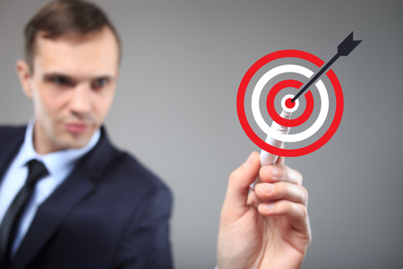 Marketing targeting, goal and trigger concepts. Businessman click on virtual target. Stock Photo