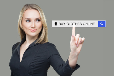 woman pressing clothes, buy online button. touch screen