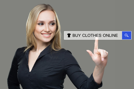 woman pressing clothes, buy online button. touch screen Stock Photo