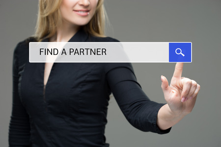 woman presses a button in the browser - to find a partner. internet concept Standard-Bild