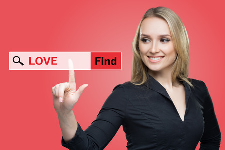 private domain: Find Love word on red virtual screen touching by business woman. browser Stock Photo