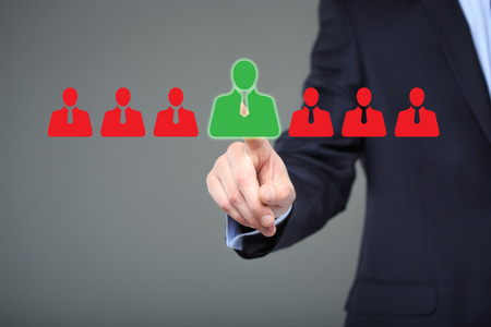 candidates: businessman choosing right partner from many candidates. technology and internet concept.