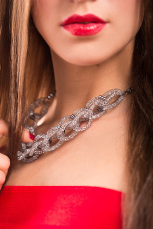 neck girl: necklace on female neck. girl holding hands. sexy red lips. close-up