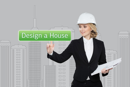 press agent: Business woman pressing desing a hause button on virtual screens. Residential Blocks. Business, technology and networking concept Stock Photo