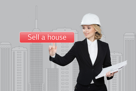 hause: Businesswoman pressing sell a hause button on virtual screens.Women finger on home icon. Isolated on office. Business, technology, internet and networking concept