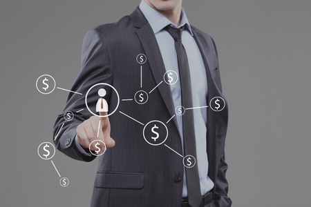 pushing button: Businessman pushing button with icon worker. dollar virtual screen Stock Photo