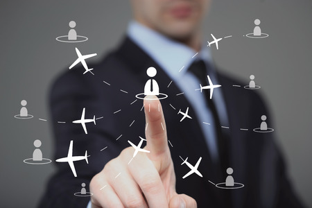 flightpath: businessman clicks on the icon employee travel. technology and internet concept.