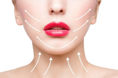 Portrait der jungen, schöne und gesunde Frau mit Pfeilen auf ihrem Gesicht. Spa, plastische Chirurgie, Gesichtslifting und Make-up-Konzept Standard-Bild - 52812842
