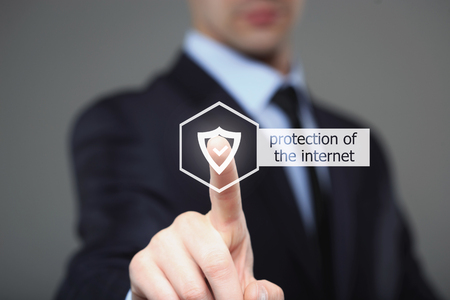 cyber defence: business, technology and internet concept - businessman pressing security button on virtual screens