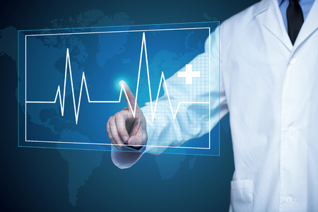 heartbeat line: doctor touching glow heartbeat line.  medical technology concept. Stock Photo