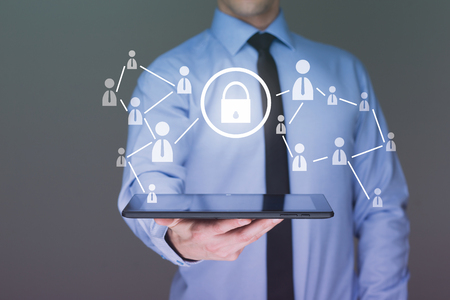 Businessman holding a tablet. with touch screen interface and cyber security concept . internet concept.