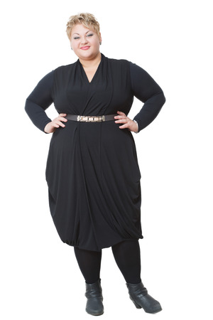 Smiling fat woman in black dress. Isolated white background