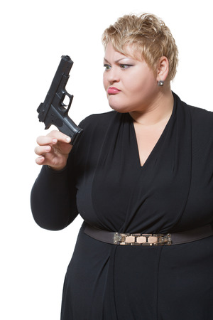 fat woman with a gun. in a black dress