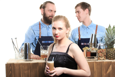 bartenders: drunk girl clings to the bartenders. Isolated on white background Stock Photo