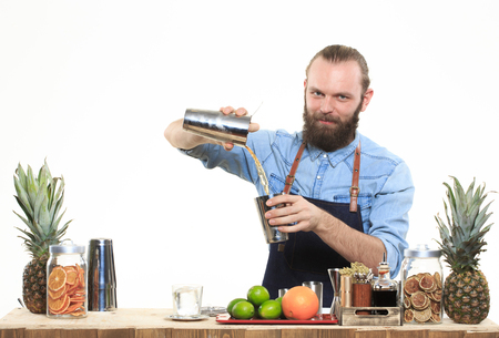 fruit bars: Young bartender with a shaker and bottle on white background Stock Photo
