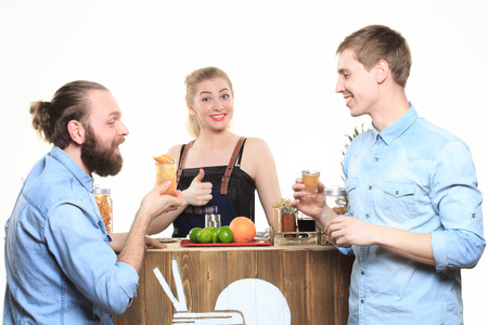 drunk girl: girl bartender and two visitors on a light background