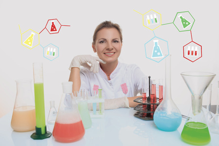 Woman chemist and chemicals in flasks, isolated on white background
