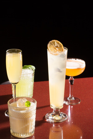 alcoholic drinks: various cocktails. alcoholic drinks on a dark background