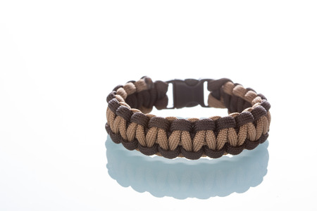 bangles hand: braided bracelet on white background.  synthetic cord