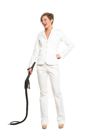 tyrant: beautiful business woman with a whip in her hands. Isolated over white background. despotic boss concept