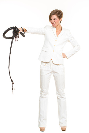 beautiful business woman with a whip in her hands. Isolated over white background. despotic boss concept