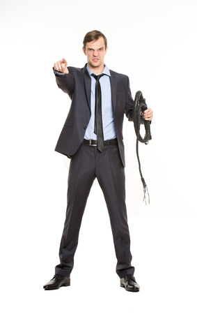 coercion: beautiful business woman with a whip in her hands. Isolated over white background. despotic boss concept