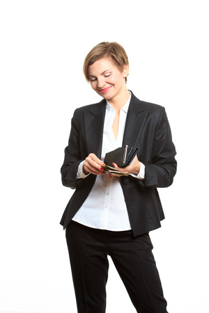 business Woman in glasses taking money from purse Stock Photo