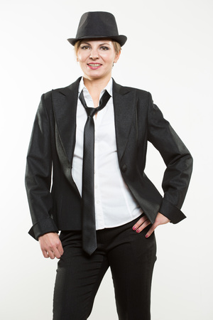 businesslike: Beautiful young woman posing in business suit. Isolated over white background.