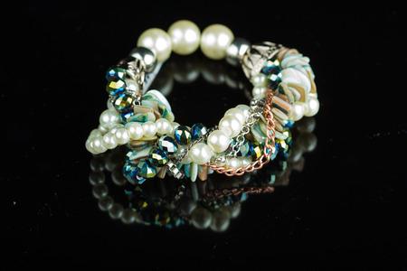 beautiful fashion bracelet on mirror black background Stock Photo
