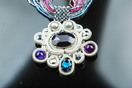 color plastic necklace close-up on black background