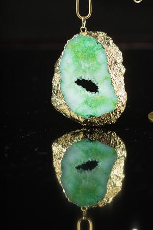 gem: green gem necklace close-up on black background