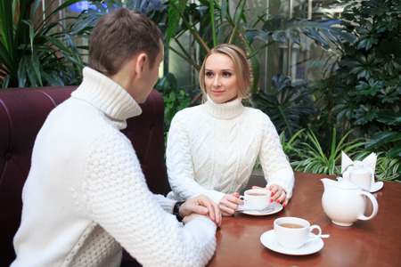 Romantic young couple drinking coffee. eat cake