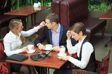 break from work: Waitress taking order from businessmen in cafe smiling laptop work