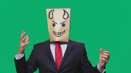 concept of emotion, gestures. a man with a package on his head, with a painted smiley angry, sly, gloating.