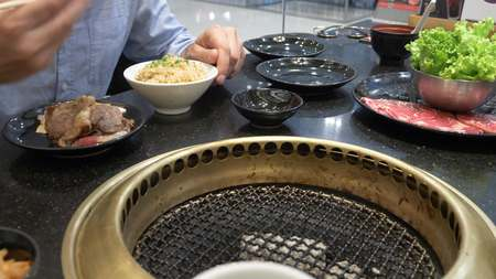 Korean barbecue grill. people cook and eat dishes cooked on a Korean grill in a restaurant. close-up