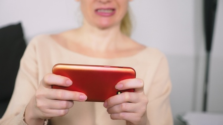 Woman playing game on smart phone.